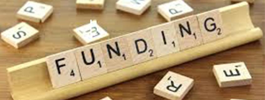 Scrabble blocks spell 'funding'